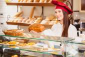 Shop assistant in a bakery — Stock Photo