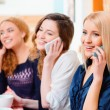 Women talking over their cell phones — Stock Photo #65549285