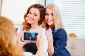 Friends making photos with their smartphone — Stock Photo