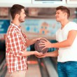 Two friends  holding a bowling ball — Stock Photo #66237849