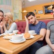 Beautiful young people in the cafe — Stock Photo #66944267
