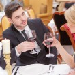 Young couple drinking wine — Stock Photo #66960805