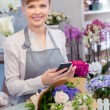 Florist with the phone in her hands — Stock Photo #68191325