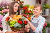 Customer and florist chosen bouquet — Stock Photo