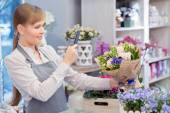 Florist making photo of a  bouquet — Stock Photo