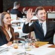 Greeting acquaintances during the business lunch — Stock Photo #68376581