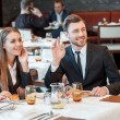 Greeting acquaintances during the business lunch — Stock Photo #68376605