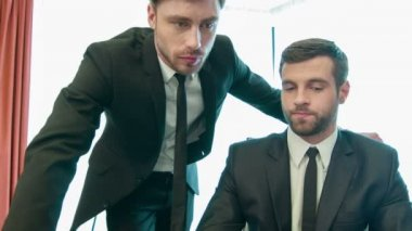 Handsome young businessmen at work — Video Stock