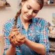 Woman holds clay in her hands — Stock Photo #68776225