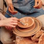 Sculpturing the clay pot — Stock Photo #68776355