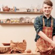 Potter washes his hands in clay studio — Stock Photo #68776767