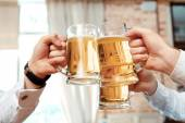 Three glasses of beer in focus — Stock Photo