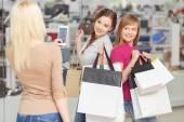 Use of phone at shopping — Stock Photo