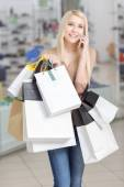 Use of phone at shopping — Stock Photo