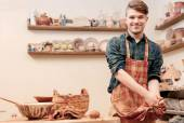 Potter washes his hands in clay studio — Stock Photo