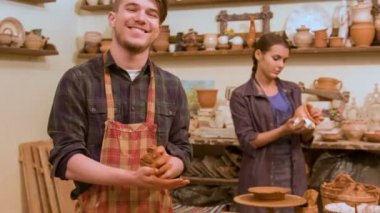 Two potters working — Vídeo de Stock