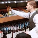 Sommelier in the store near shelves — Stock Photo #69493771