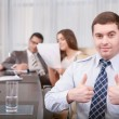 Businessman shows thumbs up — Stock Photo #69494661