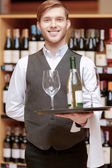 Sommelier with a tray and glasses — Stockfoto