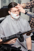 Client shaving at barber shop — Stock Photo