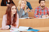 Female student smiles during lecture — Stock Photo