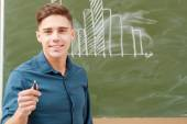 Students put graphs on a blackboard — Stock Photo