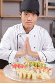 Asian chef cook welcomes guests — Stock Photo