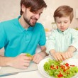 Father and son cook salad — Stock Photo #71291173