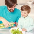 Father and son make salad dressing — Stock Photo #71291213