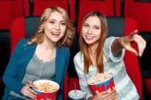 Two pretty girls in cinema — Stock Photo