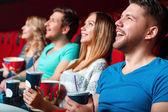 Laughing cinema visitor. — Stock Photo