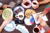 Table full of icons and pallets — Stock Photo