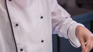 Vertical dolly shot of smiling and satisfied Asian chef — Stock Video