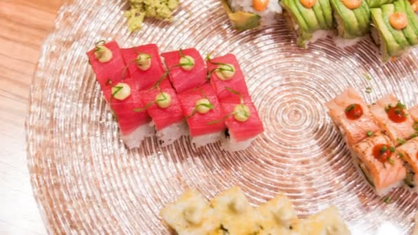 Horizontal dolly shot of different delicious rolls — Vidéo