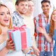 Young girls receiving presents at birthday party — Stock Photo #72940491