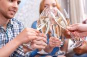 Young people celebrating with champagne — Stock Photo