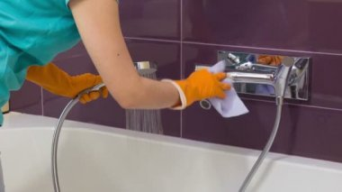 Woman cleaning shower tap — Video Stock