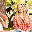 Two girls on a picnic with bikes — Stock Photo #74014737