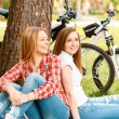 Two girls on a picnic with bikes — Stock Photo #74014697
