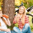 Two girls on a picnic with bikes — Stock Photo #74014741