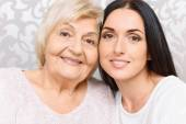 Close up of granny and granddaughter together — Stock Photo