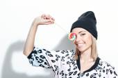 Pretty blond girl posing with candy  — Stock Photo