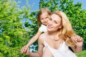 Mother holding daughter behind her back — Stock Photo