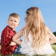 Nice little girl and boy sitting backwards — Stock Photo #76541773