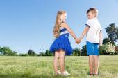 Upbeat little kids holding theur hands together  — Стоковое фото