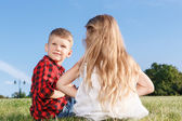 Nice little girl and boy sitting backwards — Stock Photo