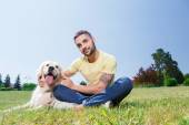 Handsome guy with his dog — Стоковое фото
