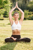 Pleasant young woman practicing yoga — Stock Photo