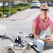 Handsome man sitting with coffee near his scooter — Stock Photo #77150591