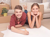 Pleasant couple drawing plan — Stock Photo
